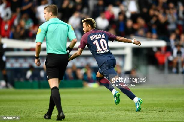 Paris SaintGermain's Brazilian forward Neymar celebrates scoring the opening goal during the French L1 football match Paris SaintGermain vs Bordeaux...