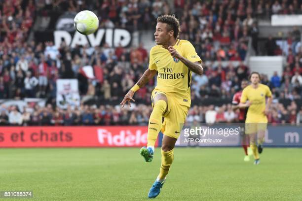 Paris SaintGermain's Brazilian forward Neymar controls the ball during the French L1 football match Paris SaintGermain vs En Avant Guingamp at the...