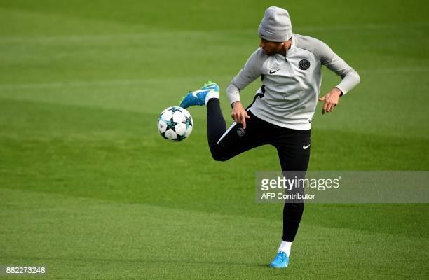 Paris SaintGermain's Brazilian forward Neymar controls the ball during a training session on October 17 2017 in SaintGermainenLaye western Paris on...