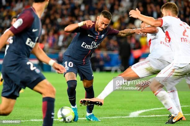 Paris SaintGermain's Brazilian forward Neymar drives the ball and scores during the French L1 football match Paris SaintGermain vs Toulouse FC at the...