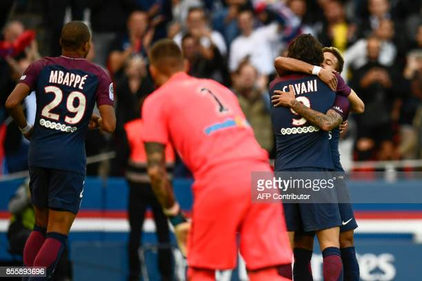 Paris SaintGermain's Brazilian forward Neymar embraces Paris SaintGermain's Uruguayan forward Edinson Cavani after cavani scored the second goal...