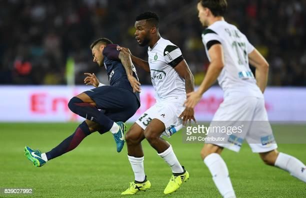 Paris SaintGermain's Brazilian forward Neymar falls next to SaintEtienne's Ivorian midfielder Habib Maiga during the French L1 football match between...
