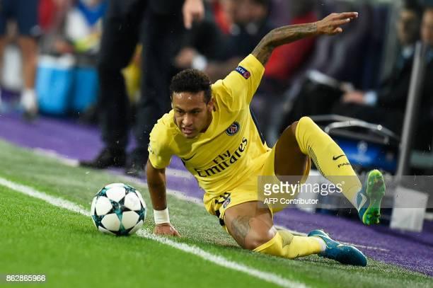 Paris SaintGermain's Brazilian forward Neymar fights for the ball during the UEFA Champions League Group B football match between RSC Anderlecht and...