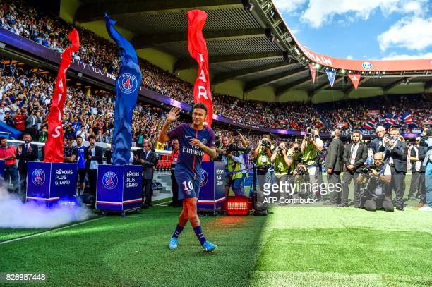Paris SaintGermain's Brazilian forward Neymar gestures as his arrives during his presentation to the fans at the Parc des Princes stadium in Paris on...