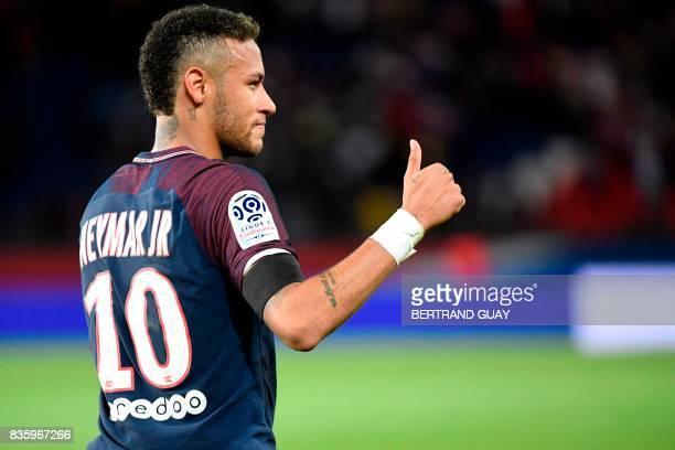 TOPSHOT Paris SaintGermain's Brazilian forward Neymar gestures during the French L1 football match Paris SaintGermain vs Toulouse FC at the Parc des...