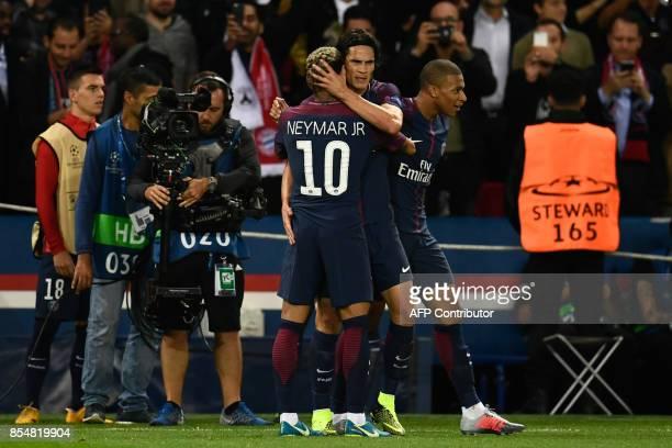 Paris SaintGermain's Brazilian forward Neymar is congratulated by Paris SaintGermain's Uruguayan forward Edinson Cavani and Paris SaintGermain's...