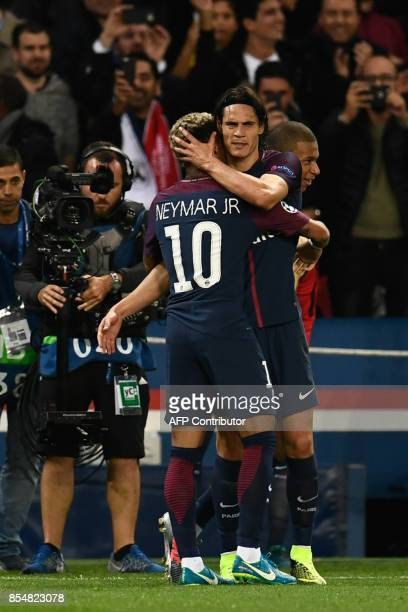 Paris SaintGermain's Brazilian forward Neymar is congratulated by Paris SaintGermain's Uruguayan forward Edinson Cavani during the UEFA Champions...