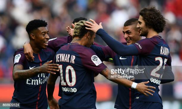 TOPSHOT Paris SaintGermain's Brazilian forward Neymar is congratuled by teammates after scoring a goal during the French L1 football match between...
