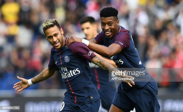 Paris SaintGermain's Brazilian forward Neymar is congratuled by Paris SaintGermain's French defender Presnel Kimpembe after scoring a free kick...
