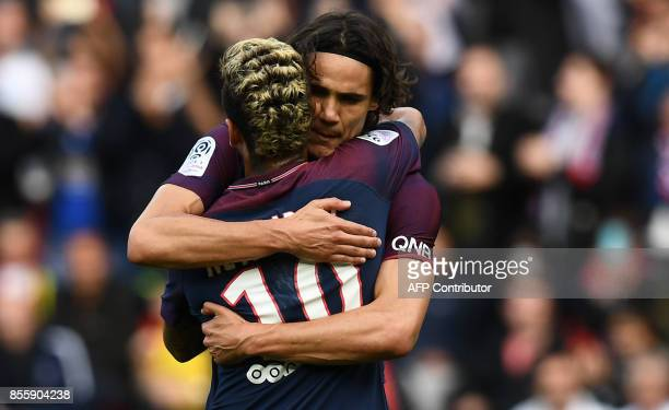 TOPSHOT Paris SaintGermain's Brazilian forward Neymar is congratuled by Paris SaintGermain's Uruguayan forward Edinson Cavani after scoring a penalty...