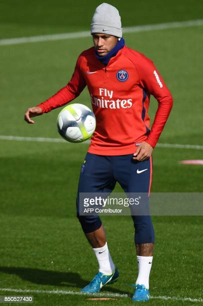 Paris SaintGermain's Brazilian forward Neymar juggles with the ball during a training session at the club's training center in SaintGermainenLaye on...
