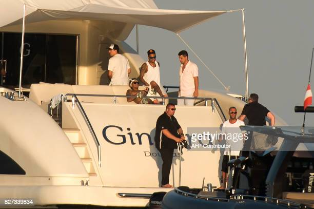 TOPSHOT Paris SaintGermain's Brazilian forward Neymar lays at the back of a yacht after leaving a beach in Ramatuelle southeastern France on August 7...