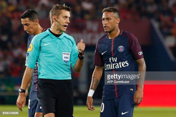 Paris SaintGermain's Brazilian forward Neymar listens to referee Clement Turpin during the French L1 football match between Paris SaintGermain and...