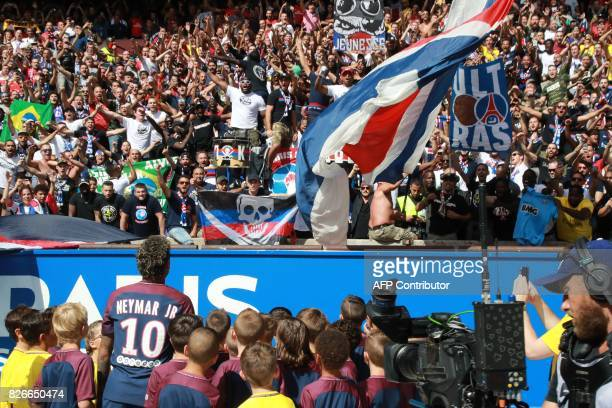 TOPSHOT Paris SaintGermain's Brazilian forward Neymar looks at the crowd during his presentation to the fans at the Parc des Princes stadium in Paris...