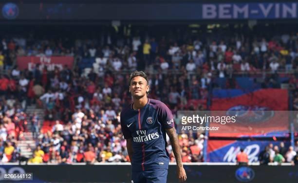 Paris SaintGermain's Brazilian forward Neymar looks on during his presentation to the fans at the Parc des Princes stadium in Paris on August 5 2017...