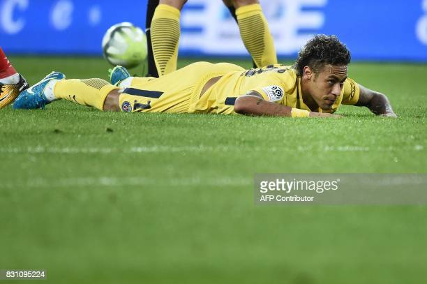 Paris SaintGermain's Brazilian forward Neymar looks on during the French L1 football match Paris SaintGermain vs En Avant Guingamp at the Roudourou...