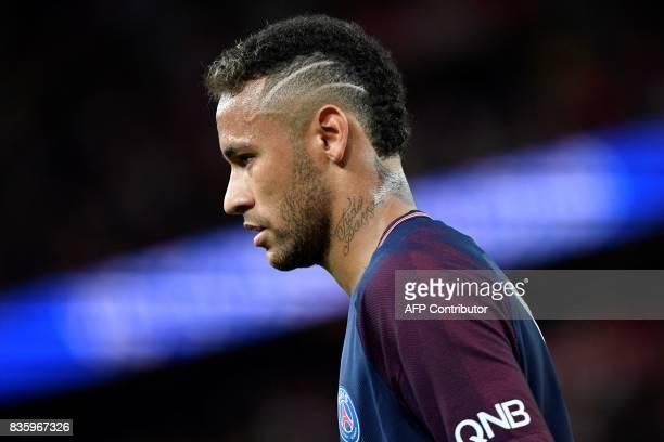 Paris SaintGermain's Brazilian forward Neymar looks on during the French L1 football match Paris SaintGermain vs Toulouse FC at the Parc des Princes...