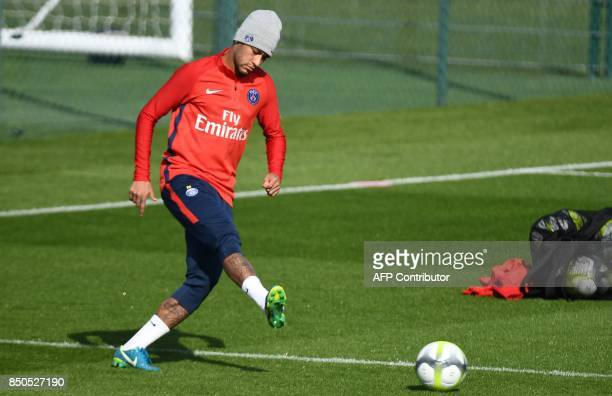 Paris SaintGermain's Brazilian forward Neymar passes the ball during a training session at the club's training center in SaintGermainenLaye on...