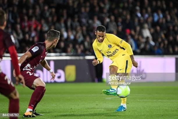 Paris SaintGermain's Brazilian forward Neymar passes the ball during the French L1 football match between Metz and Paris SaintGermain on September 8...