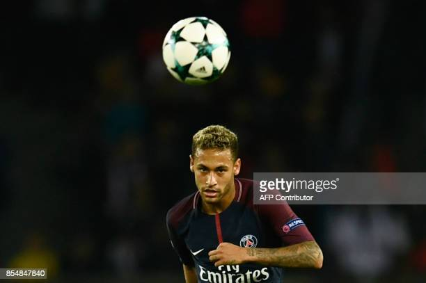 Paris SaintGermain's Brazilian forward Neymar passes the ball during the UEFA Champions League football match between Paris SaintGermain and Bayern...