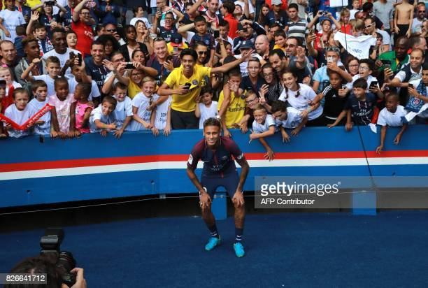 TOPSHOT Paris SaintGermain's Brazilian forward Neymar poses for a photograph during his presentation to the fans at the Parc des Princes stadium in...