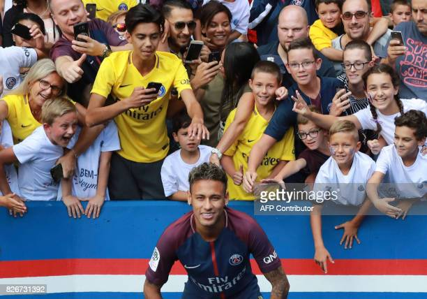 Paris SaintGermain's Brazilian forward Neymar poses for a photograph during his presentation to the fans at the Parc des Princes stadium in Paris on...