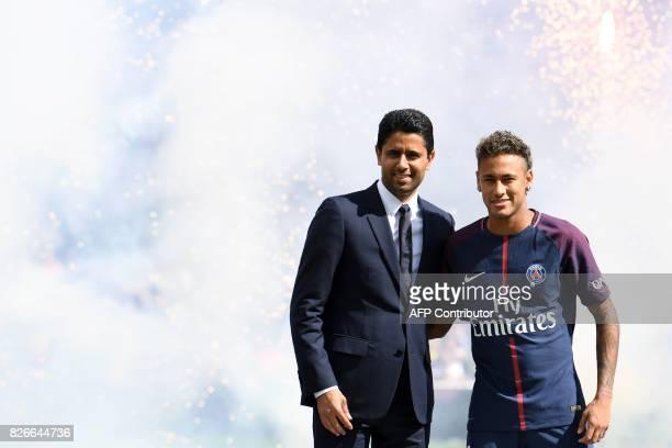 Paris SaintGermain's Brazilian forward Neymar poses with Paris Saint Germain's Qatari president Nasser AlKhelaifi during his presentation to the fans...