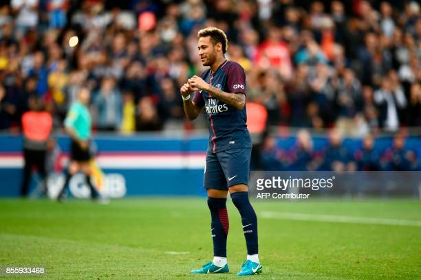 Paris SaintGermain's Brazilian forward Neymar reacts after scoring a penalty kick during the French L1 football match Paris SaintGermain vs Bordeaux...