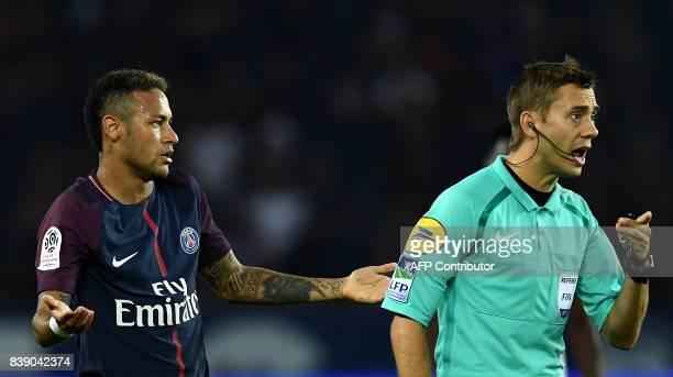 Paris SaintGermain's Brazilian forward Neymar reacts as referee Clement Turpin gestures during the French L1 football match between Paris...