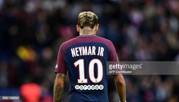 Paris SaintGermain's Brazilian forward Neymar reacts during the French Ligue 1 football match between Paris SaintGermain and Bordeaux at the Parc des...