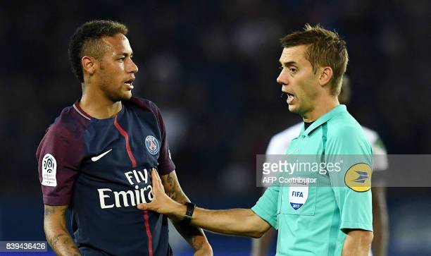 Paris SaintGermain's Brazilian forward Neymar reacts next to French referee Clement Turpin during the French Ligue 1 football match between Paris...
