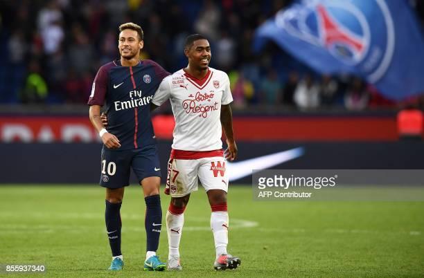 Paris SaintGermain's Brazilian forward Neymar shares a laugh with Bordeaux's Brazilian forward Malcom at the end of the French L1 football match...