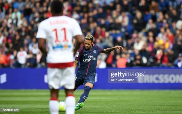 Paris SaintGermain's Brazilian forward Neymar shoots to score a free kick during the French L1 football match Paris SaintGermain vs Bordeaux on...