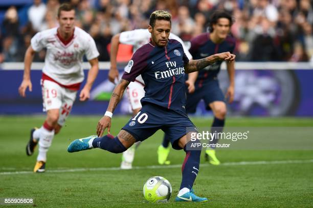 Paris SaintGermain's Brazilian forward Neymar shoots to score a penalty kick during the French L1 football match Paris SaintGermain vs Bordeaux on...