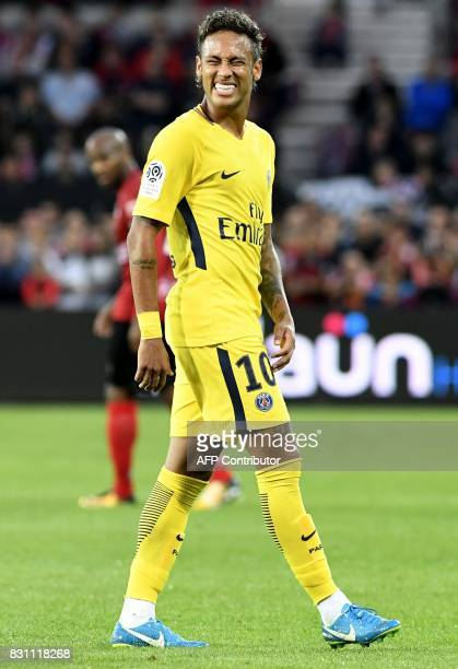 Paris SaintGermain's Brazilian forward Neymar smiles during the French L1 football match Paris SaintGermain vs En Avant Guingamp at the Roudourou...