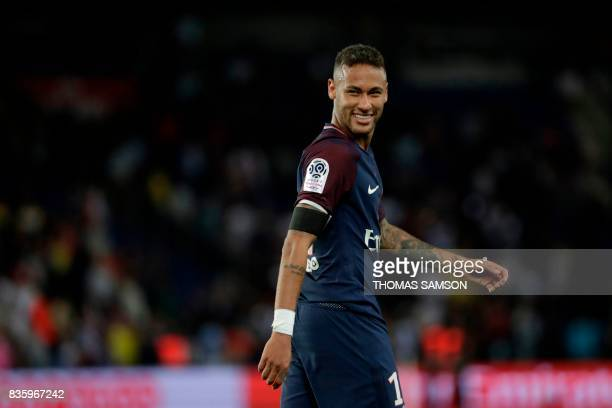 TOPSHOT Paris SaintGermain's Brazilian forward Neymar smiles during the French L1 football match Paris SaintGermain vs Toulouse FC at the Parc des...