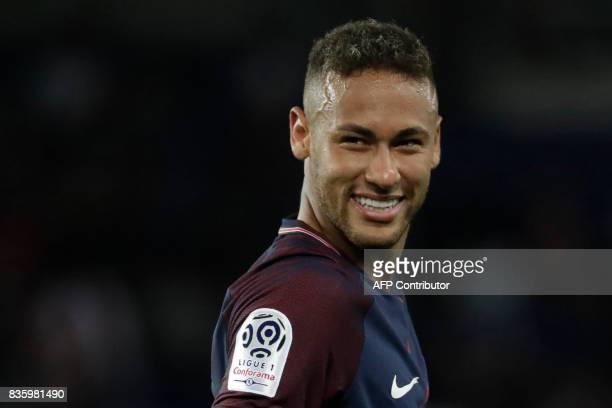 Paris SaintGermain's Brazilian forward Neymar smiles during the French L1 football match Paris SaintGermain vs Toulouse FC at the Parc des Princes...