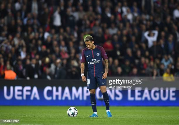 Paris SaintGermain's Brazilian forward Neymar stands by the ball during the UEFA Champions League football match between Paris SaintGermain and...