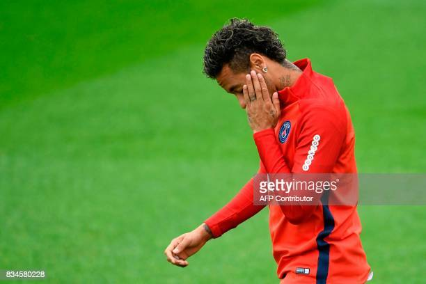 Paris SaintGermain's Brazilian forward Neymar takes part in a training session at the Camp des Loges in SaintGermainenLaye near Paris on August 18...