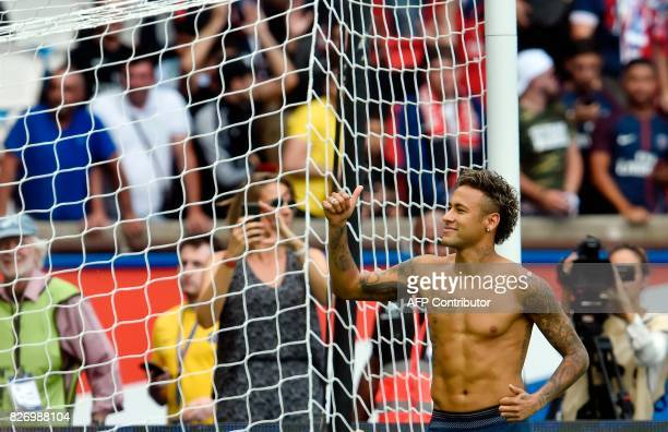 Paris SaintGermain's Brazilian forward Neymar thumbs up during his presentation to the fans at the Parc des Princes stadium in Paris on August 5 2017...