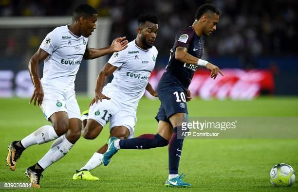 Paris SaintGermain's Brazilian forward Neymar vies for the ball with SaintEtienne's Ivorian midfielder Habib Maiga during the French L1 football...