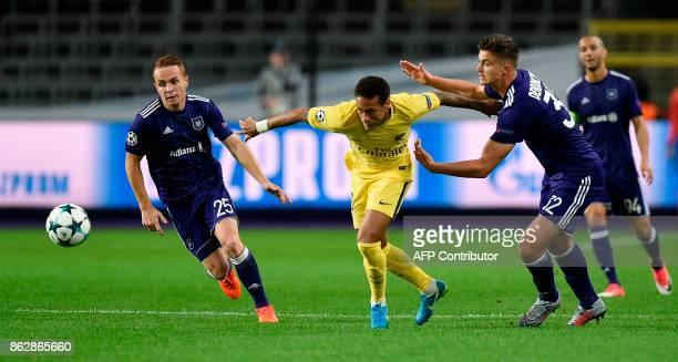 Paris SaintGermain's Brazilian forward Neymar vies with Anderlecht's French midfielder Adrien Trebel and Anderlecht's Belgian midfielder Leander...