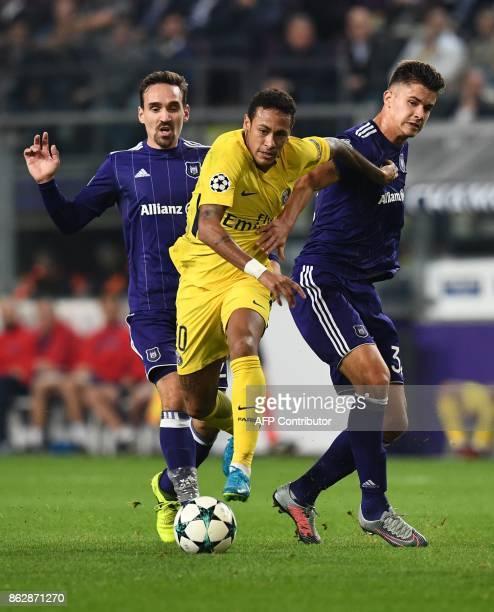 Paris SaintGermain's Brazilian forward Neymar vies with Anderlecht's Belgian midfielder Sven Kums and Anderlecht's Belgian midfielder Leander...