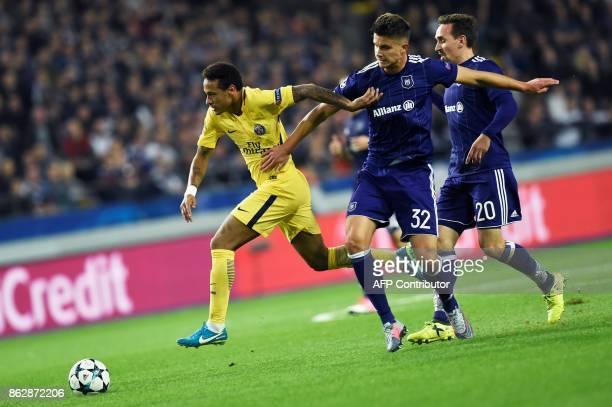 Paris SaintGermain's Brazilian forward Neymar vies with Anderlecht's Belgian midfielder Leander Dendoncker and Anderlecht's Belgian midfielder Sven...