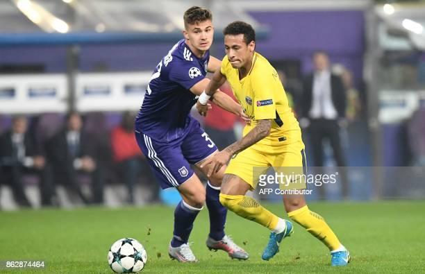 Paris SaintGermain's Brazilian forward Neymar vies with Anderlecht's Belgian midfielder Leander Dendoncker during the UEFA Champions League Group B...