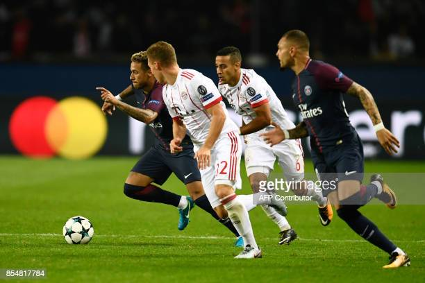 Paris SaintGermain's Brazilian forward Neymar vies with Bayern Munich's German midfielder Joshua Kimmich during the UEFA Champions League football...