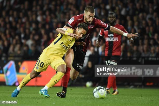TOPSHOT Paris SaintGermain's Brazilian forward Neymar vies with Guingamp's French midfielder Lucas Deaux during the French L1 football match Paris...