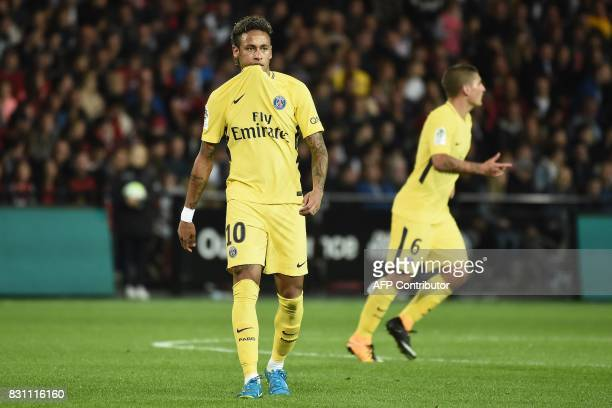 Paris SaintGermain's Brazilian forward Neymar walks during the French L1 football match Paris SaintGermain vs En Avant Guingamp at the Roudourou...