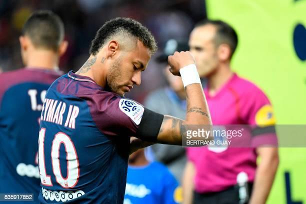 TOPSHOT Paris SaintGermain's Brazilian forward Neymar walks on the pitch prior to the French L1 football match Paris SaintGermain vs Toulouse FC at...