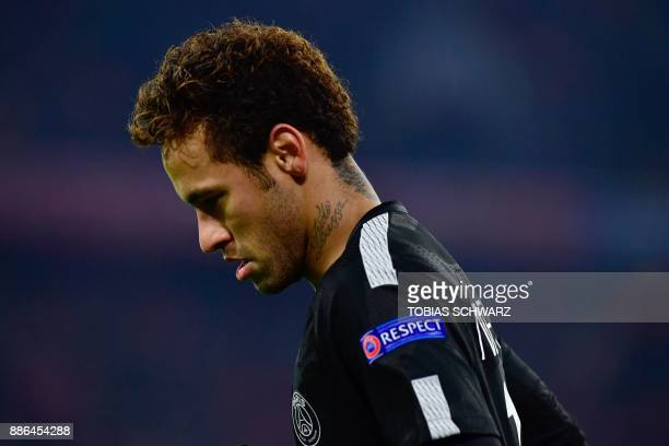TOPSHOT Paris SaintGermain's Brazilian forward Neymar walks over the pitch during the UEFA Champions League football match of Bayern Munich vs Paris...